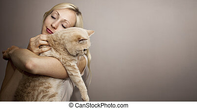 Young Woman with Cat - Young Woman loves her cute Cat