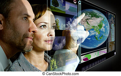 man an d woman are working with futuristic screen