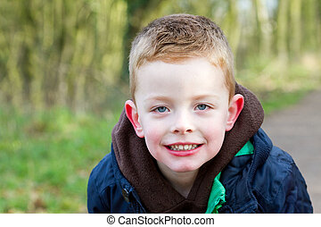 boy relaxing in the park