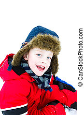 little boy playing in the snow wearing a red jacket