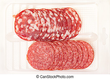 Slices Salami in container on a white background