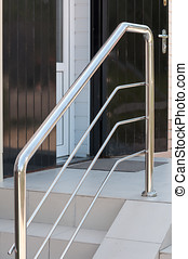 Metal handrail at an entrance in a building