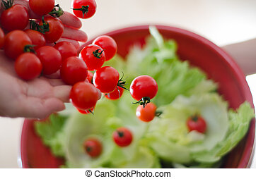Cherry Tomatoes - Some cherry tomatoes being poured onto...