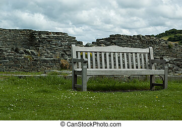 Castle Ruin Bench Viewpoint - A sterdy bench on a green...