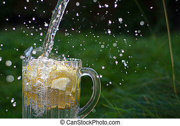 Water Poured Onto Lemons - Water pouring and splahing into...