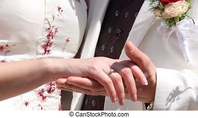 Hands of the newly-weds - The newly-weds holding out hands...
