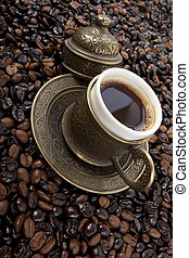 Cup of Turkish coffee - Cup of black coffee on a saucer on...