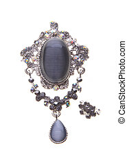 brooch with different gems on background - brooch with...