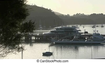 Car ferry leaving Opua wharf - View over Opua wharf early...