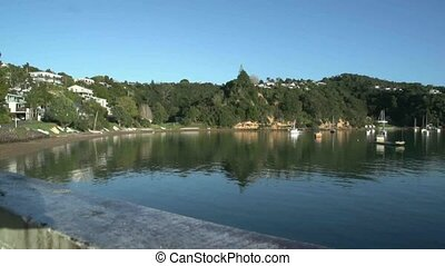 Boats moored at Opua. - Pan across Opua harbour in The Bay...