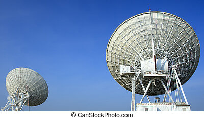 Radiotelescopes at the Very Large Array with blue sky...