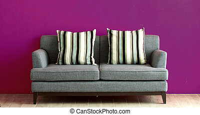 gray sofa put on red stucco background