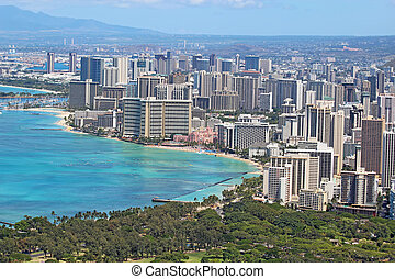 Aerial view of the skyline of Honolulu, Oahu, Hawaii, showing the downtoan and hotels around Waikiki Beach and other areas