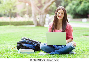 Hispanic college student with laptop - A shot of a hispanic...