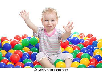 Hsppy boy playing colorful balls isolated on white