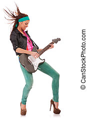 woman guitarist playing rock and roll