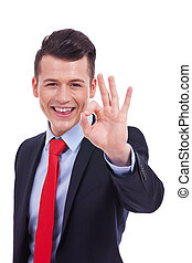business man giving you OK sign - Portrait of smiling...