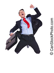 super excited business man with briefcase jumping in mid air...