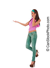 young woman in jeans and high heels shoes presenting