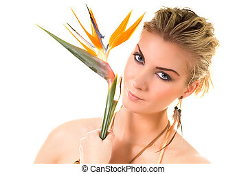 Beautiful woman with bird of paradise floser isolated on...