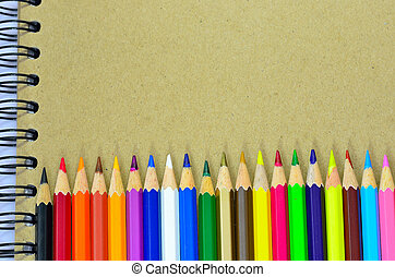 color pencils and note book - Various colour pencils and...