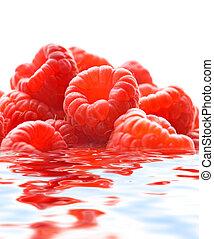 Raspberries reflected in water