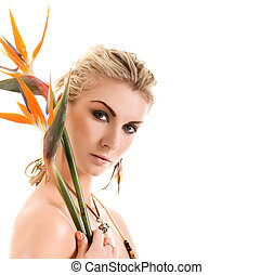 Sexy blonde woman with strelizia flowers isolated on white...