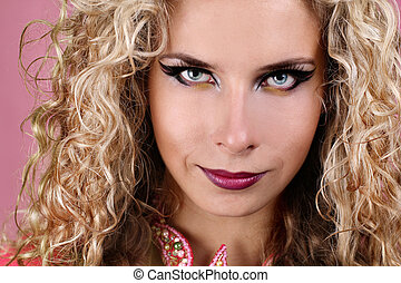 Portrait of woman with blue eyes and blonde curly hair