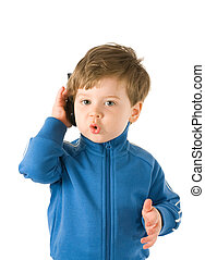 Little boy talking on the phone. Isolated on white...