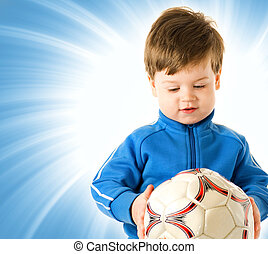 Handsome boy with soccer ball over abstract blue background
