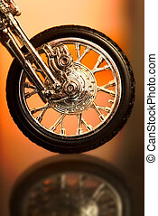 Motorcycle wheel on abstract background