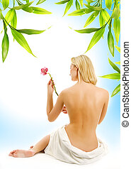 Beautiful young woman with orchid flower