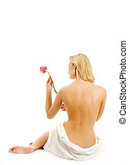 Beautiful young woman with orchid flower isolated on white...
