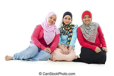 Muslim women - Portrait of three cheerful muslim women...