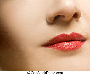 Beautiful womans face with red lips