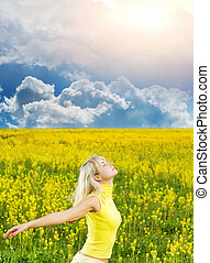 Happy young woman in a flower field