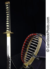 kendo concept studio shot - katana sword and kendo helmet...