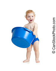 Happy baby kid standing with blue plastic wash bowl