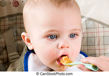 Hungry Baby - parent feeding a cute baby healthy food