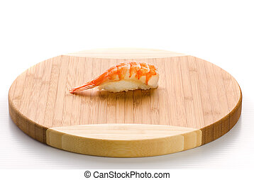 Shrimp sushi on a wooden plate. Isolated on white background