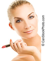 Beautiful young woman with pink lipstick close-up portrait....