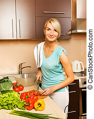 Beautiful young woman making vegetarian vegetable salad