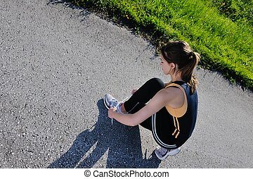 Young beautiful  woman jogging
