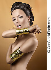 sexy brunette with two golden bracelets, with open mouth