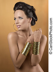 sexy brunette with two golden bracelets, she smiles