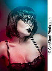 Lingerie woman, beautiful young in a black mysterious venetian mask