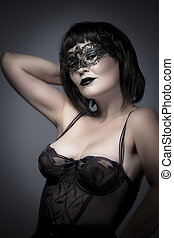 Beautiful woman with Venetian mask and corset, sensual, sexy...