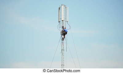 Engineers in work - Engineers-fitters install antenna for...