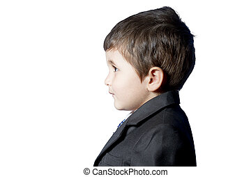 Child dressed in suit and tie