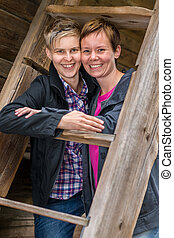 Two lesbians - Two girls smiling posing together in old...